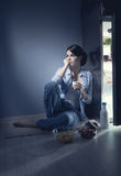 Sleepless woman having a glass of milk Royalty Free Stock Photography