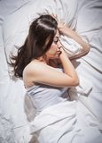 Insomnia sleepless depressed woman. Sleepless woman lying in bed Royalty Free Stock Images
