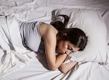 Insomnia sleepless depressed woman. Sleepless woman lying in bed Royalty Free Stock Photography