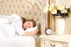 Sleepless woman lying in bed Stock Image