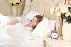 Sleepless woman lying in bed Royalty Free Stock Image