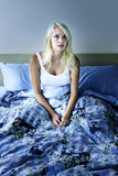 Sleepless woman at night. Sleepless woman sitting up in bed with insomnia stock images