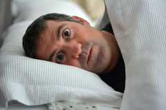 Sleeplessness man. Suffering from Insomnia sleep disorder. Real people. Copy space Royalty Free Stock Photography