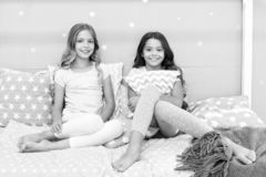 Sleepover time for fun gossip story. Best friends forever. Soulmates girls having fun bedroom interior. Childhood. Friendship concept. Girls best friends stock images