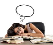 Sleeps and dreams. A woman sleeps and dreams over books stock photo