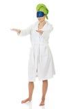 Sleepwalking woman in bathrobe. Royalty Free Stock Photography