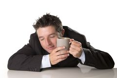 Sleepy addict businessman holding take away coffee in caffeine addiction Royalty Free Stock Image