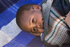 Sleepy african child. Portrait of African child sleeping in the yard, location Mmankodi village , Botswana stock photo