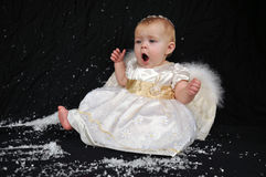 Sleepy angel in the snow Royalty Free Stock Photography