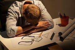 Sleepy architect at night Stock Image