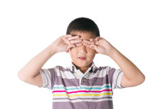 Sleepy Asian kid, put hand on his eyes, isolated on white backgr Stock Image