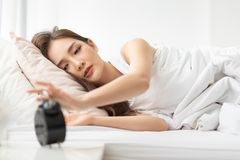 Girl is having trouble waking up royalty free stock photography