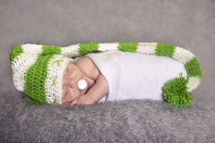 Sleepy baby in elf hat Royalty Free Stock Image