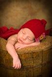 Sleepy baby in grunge bucket Royalty Free Stock Photos