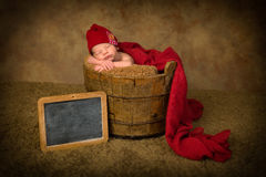 Sleepy baby with name plate Royalty Free Stock Photos