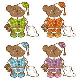 Sleepy bear in pajamas with a pillow and soft toy Royalty Free Stock Photo