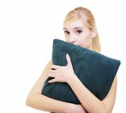 Sleepy blond girl with green pillow isolated over white Stock Photography