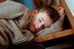 Sleepy boy Stock Photos