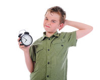 Sleepy boy with alarm-clock Stock Image