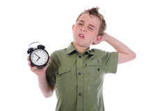 Sleepy boy with alarm-clock Stock Photos
