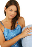 Sleepy brunette with blue pillow over white Stock Photo