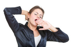 Sleepy business woman yawning and stretching, isolated Stock Images