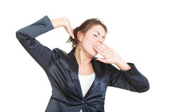 Sleepy business woman yawning and stretching, isolated Stock Photo