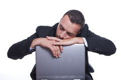 Sleepy businessman with his laptop taking break Stock Photo