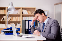 The sleepy businessman working in office. Sleepy businessman working in office Royalty Free Stock Photo