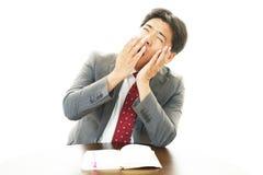 Sleepy Businessman yawning Stock Photography