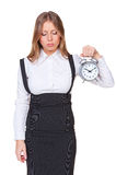 Sleepy businesswoman holding alarm clock Royalty Free Stock Image