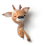 Sleepy cartoon deer looks out from behind a paper Stock Images