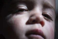 Sleepy child. Close up portrait of face of sleepy child royalty free stock photography