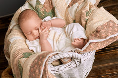 Sleepy child in a basket. Cute infant touching his face. How much sleep babies need royalty free stock photo