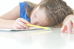 Sleepy child at school work. Young girl falling asleep during school work stock image