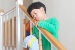 A sleepy child try to wake himself. A sleepy child try to wake himself by standing and walking in the morning stock photo