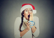 Free Sleepy Christmas Woman Yawning Holding Cup Of Hot Beverage Stock Image - 81208541