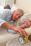 Sleepy couple with alarm clock Stock Photography