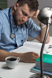 Sleepy doctor with coffee Stock Photo