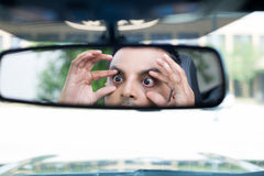 Sleepy driver reactions in rearview Royalty Free Stock Image