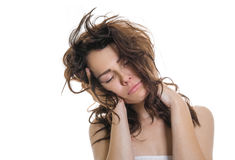 Sleepy or drowsy young girl. Isolated on white. Unkempt tired girl stock photo