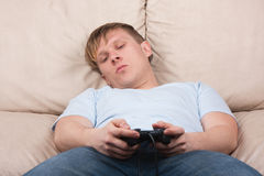 Sleepy gamer Stock Image
