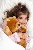 Sleepy girl. Beautiful young girl in bed with teddy bear Royalty Free Stock Photo