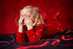 Sleepy girl toddler rubbing her eyes Royalty Free Stock Photo