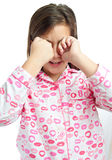 Sleepy girl wearing pajamas isolated on white Royalty Free Stock Photography