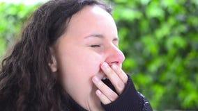 Sleepy girl yawning stock video footage