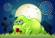 A sleepy green monster at the amusement park Royalty Free Stock Images