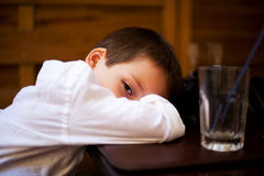 Sleepy head on table Royalty Free Stock Photography