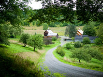 Sleepy Hollow Farm, Vermont. New England country side estate with pond, barns and fields royalty free stock photo