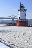 Sleepy Hollow Lighthouse Winter. Sleepy Hollow lighthouse in front of the Tappan Zee Bridge on an icy Hudson River in New York stock photography